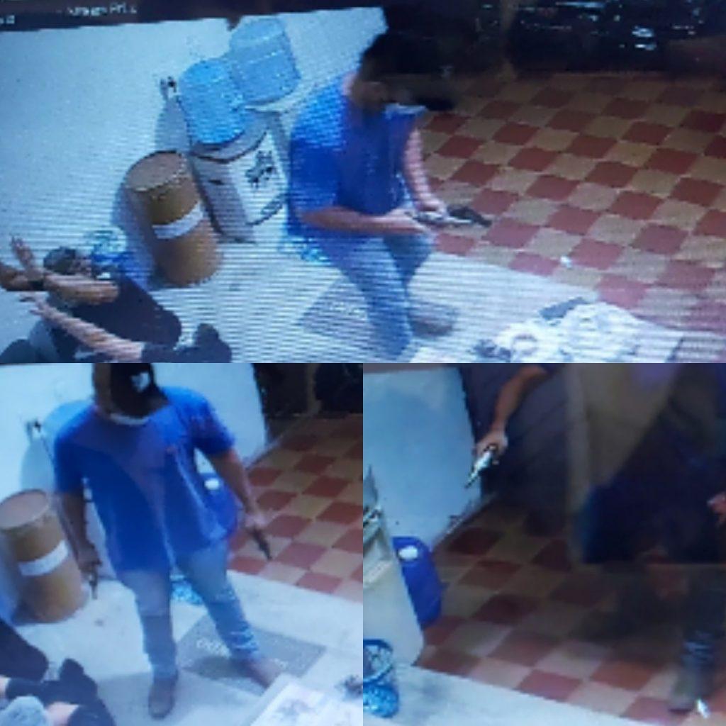 (Imagens: Ladrão com uma das armas usadas no roubo ao Armazém de Bola)